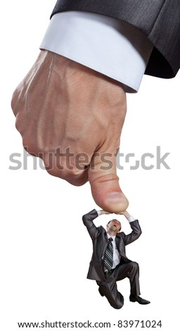 Big hand pushing businessman. Isolated on white