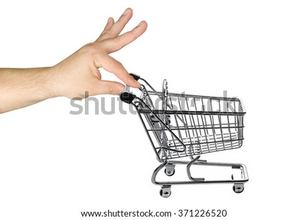 Big hand pushing empty shopping cart isolated - stock photo