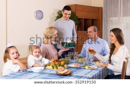 Big happy family celebrating birthday at festive dinner - stock photo