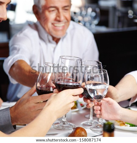 Big happy family eating and drinking together at the table - stock photo