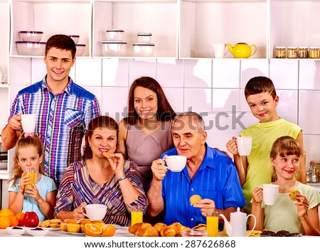 Big happy family have breakfast at kitchen. Three generations. - stock photo