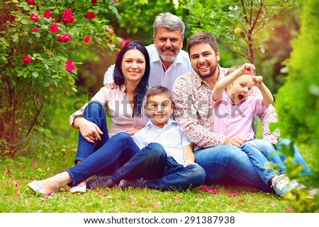 big happy family together in summer garden - stock photo