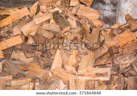 Big heap of chopped firewood for a wood burning stove. - stock photo