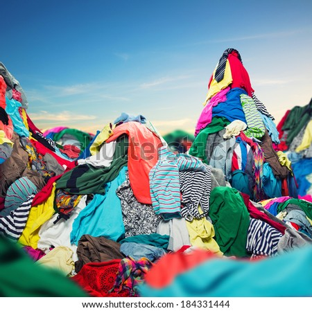 Big heap of colorful clothes - stock photo