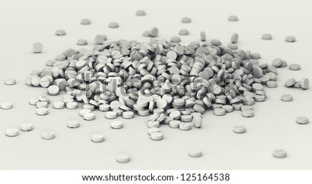 Big heap of pills scattered on the ground - stock photo