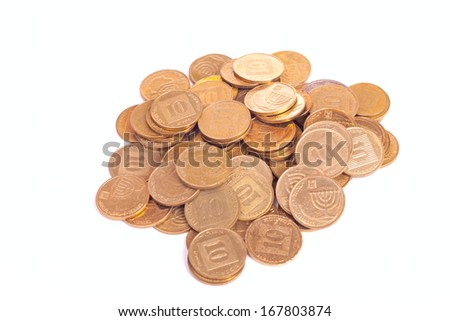 Big heap of small Israeli coins isolated on white background - stock photo