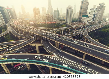 Big highway junction in Shanghai, China with traffic. Famous landmark of Shanghai in the evening. - stock photo