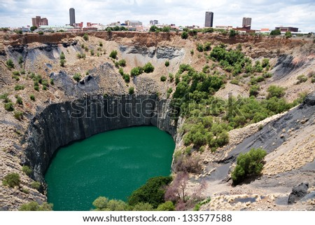 big hole in kimberley, south africa, where De Beers diamond company originated and diamonds were dug out by hand. Largest man made hole on earth - stock photo