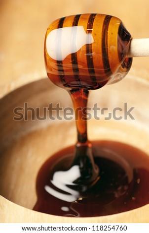 Big honey spill showing translucent syrup on wood - stock photo