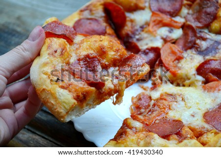 Big hot pizza with tomatoes and pepperoni
