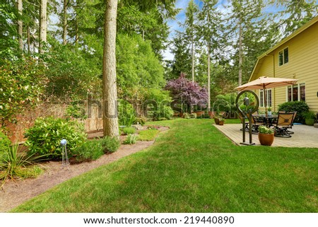 Big house with backyard patio and landscape design - stock photo