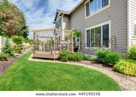 Big house with covered backyard patio and landscape design - stock photo