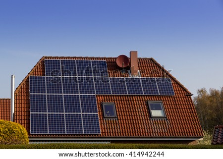 big house with solar panels on the roof