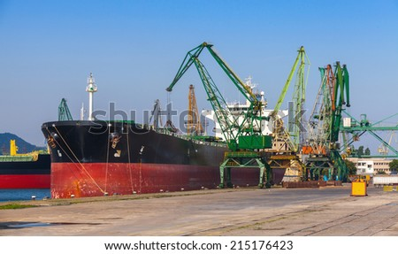 Big industrial cargo ship loading in port of Varna