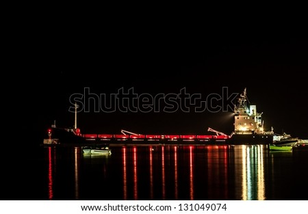 Big Industrial cargo ship on the water - stock photo
