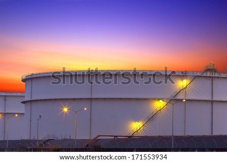 big Industrial chemical tanks in a refinery at twilight - stock photo