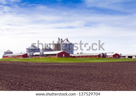 Big Industrial Farm With Cloudy Sky - stock photo