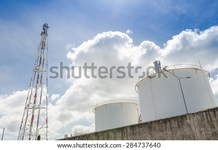 Big industrial oil tanks in a refinery base - stock photo