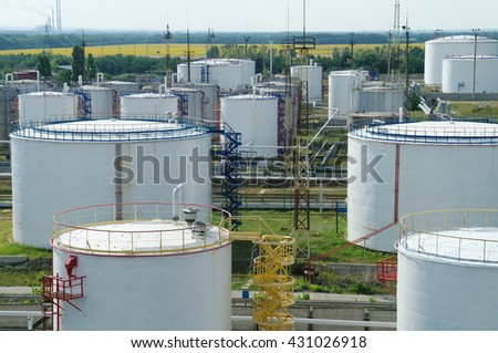 Big industrial oil tanks in a refinery base. - stock photo
