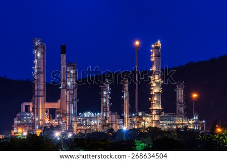 Big Industrial oil tanks in a refinery with treatment pond at industrial plants.