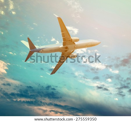 Big jet plane flying against perfect sky background  - stock photo