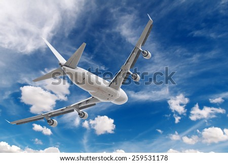big jet plane flying on blue cloudy skybackground - stock photo