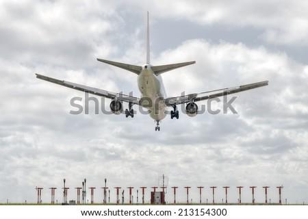 big jet plane landing on airport track - stock photo