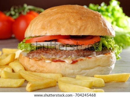 Big juicy gourmet burger with chips