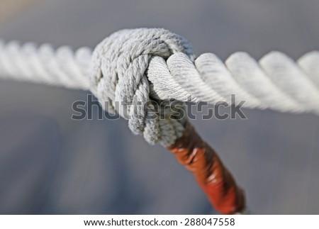 big knot with sturdy hemp Tibetan bridge - stock photo
