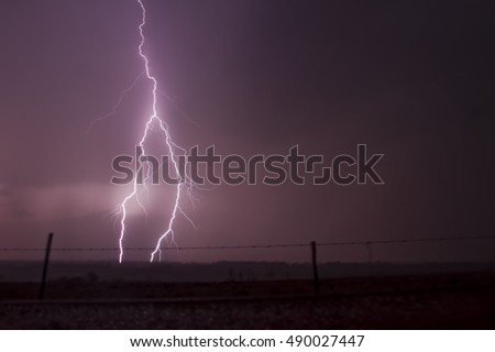 Big Lightning Strikes over Remote Farmlands in the Early Evening