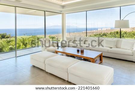 big living room with beautiful sea view - stock photo