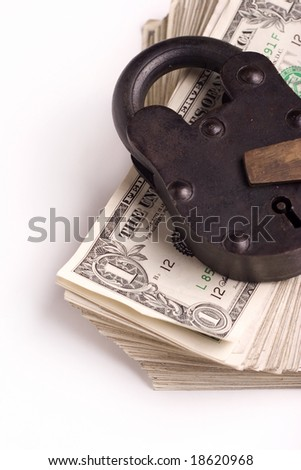 big lock on a stack of money - stock photo