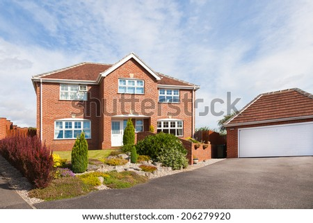 Big luxury house and garage - stock photo
