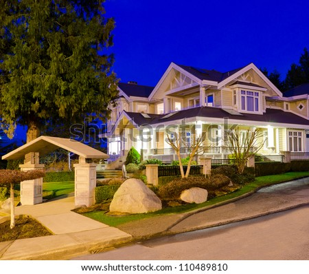 Big luxury house at dusk, night in suburbs of Vancouver, Canada - stock photo