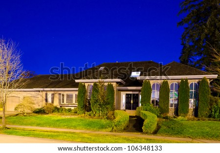 Big luxury house at night ( dawn ) time in suburbs of Vancouver. Canada.