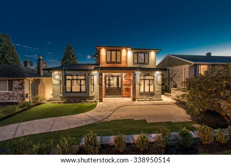 Big luxury, modern house at dusk, night time in suburbs of Vancouver, Canada. - stock photo