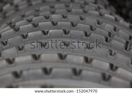 Big machines tires stack background. Industrial tires