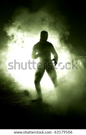Big man in abstract smoke