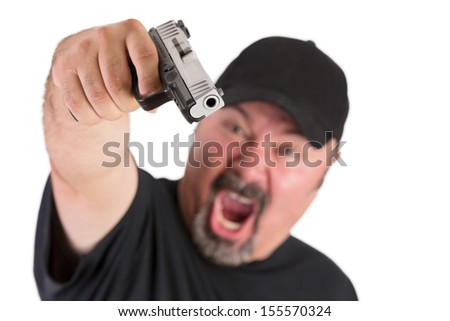 Big man with goatee points his gun to you with a loud scream, make sure do whatever he says, stop thinking, focus on the gun, isolated on white - stock photo