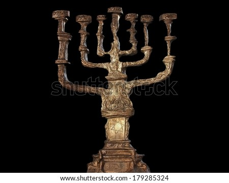 Big menorah isolated on black background - stock photo