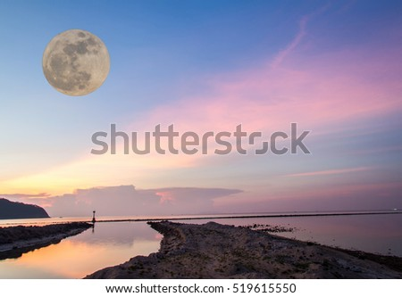 Big moon and beach with light the fisherman and background
