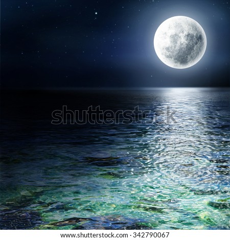 Big moon over the ocean. Seascape and moonlight. A high resolution.