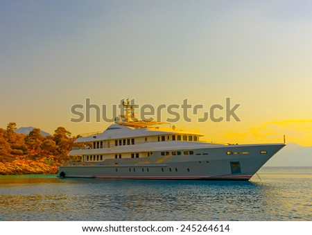 big motor yacht anchored at Agkistri island in Greece - stock photo