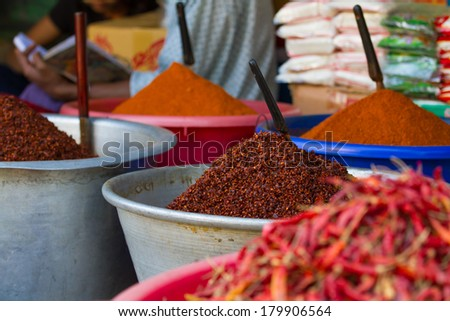 Big mounds of hot, spicy red chilli powder for sale at a market in Myanmar (Burma) - stock photo