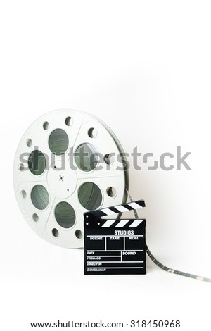 Big movie reel and 35 mm film - stock photo