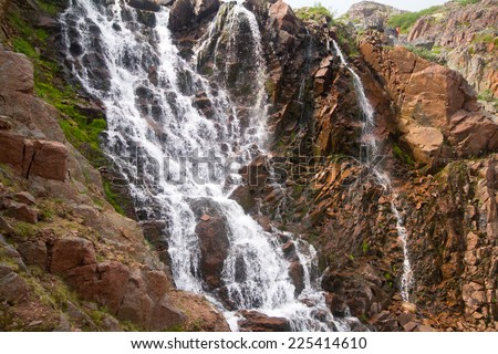 big northern beautiful waterfalls on the seashore. Leviathan movie location - stock photo