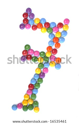 Big number seven made of candies isolated on white