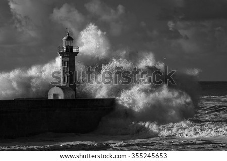 Big ocean stormy waves over old lighthouse of Douro mouth granite pier. Used infrared filter.