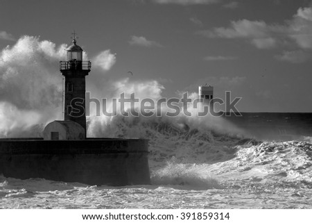 Big ocean stormy waves over old lighthouse of Douro mouth granite pier. Used infrared filter.  - stock photo