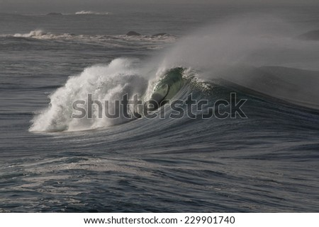 Big ocean wave approaching the portuguese coast. - stock photo